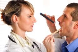 Обращение к стоматологу при появлении рецессии десны